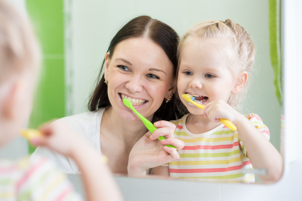 Mother teaching daughter brush teeth Stock Photo 02