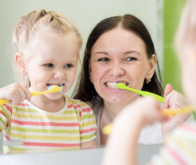 Mother teaching daughter brush teeth Stock Photo 03