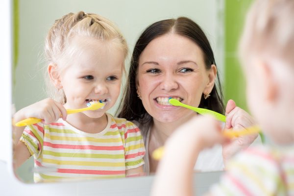 Mother teaching daughter brush teeth Stock Photo 03