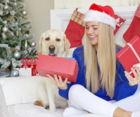 Open Christmas presents girl Stock Photo