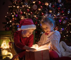 Open presents on Christmas Eve children Stock Photo
