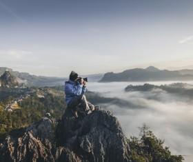Photographers shooting nature scenery Stock Photo
