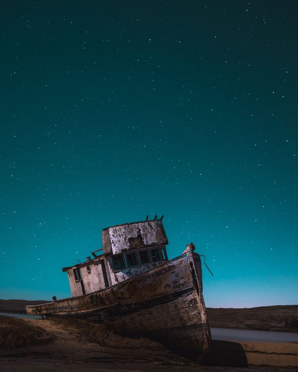 Reyes sunken ship under the night sky Stock Photo free download