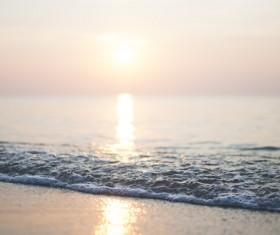 Ripple wave on beach at sunset Stock Photo