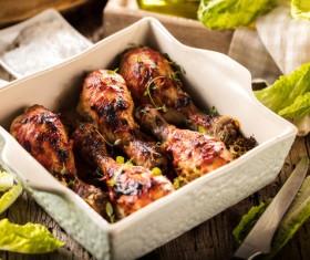 Roasted chicken legs packed in food boxes Stock Photo