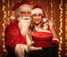 Santa Claus and girl hold gift Stock Photo