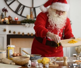 Santa Claus makes food Stock Photo