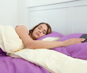 Sleeping girl and smartphone Stock Photo