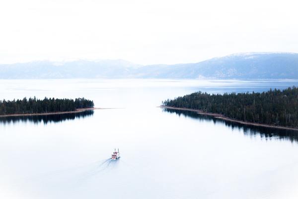 Small boat on beautiful calm bay Stock Photo