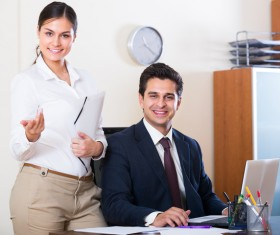 Smiling boss with secretary Stock Photo 01