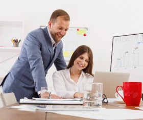 Smiling boss with secretary Stock Photo 02