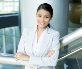 Smiling woman standing on stairs Stock Photo
