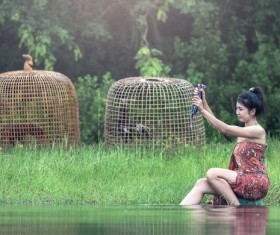 Southeast Asia girl washing clothes in the river Stock Photo