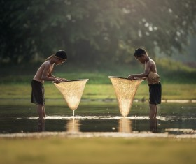 Southeast Asian children who catch fish in small rivers Stock Photo
