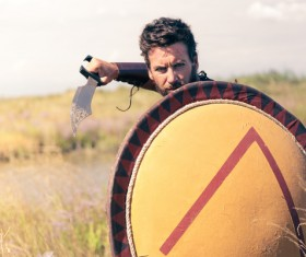Spartan man holding a shield with knife Stock Photo