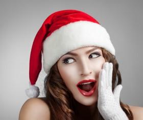 Surprised girl wearing christmas hat Stock Photo