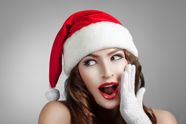 Surprised girl wearing christmas hat Stock Photo