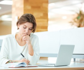Thinking woman writing record Stock Photo