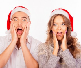 Wearing Christmas hat exaggerated facial expressions couples Stock Photo 02