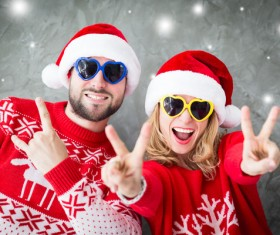 Wearing Christmas hat exaggerated facial expressions couples Stock Photo 03