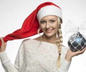 Wearing Christmas hats girl holding a Christmas ball Stock Photo