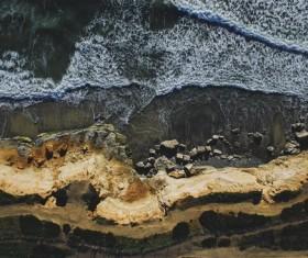 White foam seaside from altitude Stock Photo