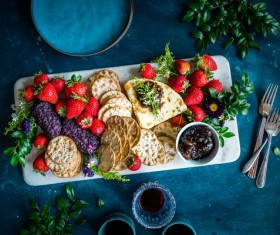 Wine cheese biscuits and berries Stock Photo