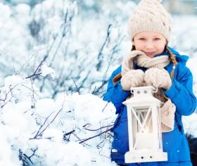 Winter outdoor little girl holding a lantern Stock Photo