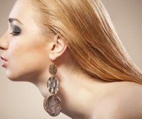 Woman fashion earrings Stock Photo