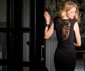 Woman in Evening Black Dress with Black Lace pattern Stock Photo
