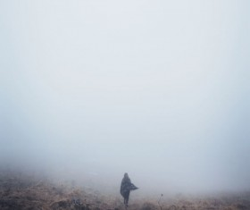 Woman in thick fog Stock Photo