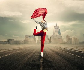 Woman jumping on the road Stock Photo