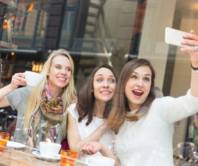 Woman taking photos with smartphone in coffee house Stock Photo 01