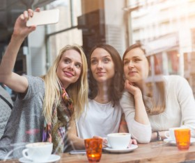 Woman taking photos with smartphone in coffee house Stock Photo 02