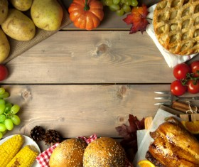 Wooden table filled with all kinds of food Stock Photo