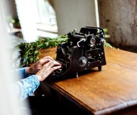 working on vintage typing machine Stock Photo