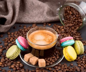 A cup of aromatic coffee and macarons Stock Photo