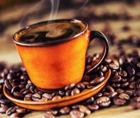 A cup of fragrant coffee and coffee beans Stock Photo 02