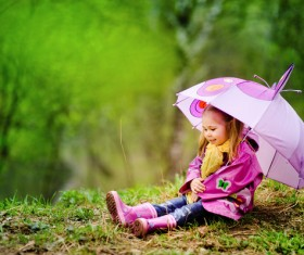 Adorable little girl with umbrella Stock Photo
