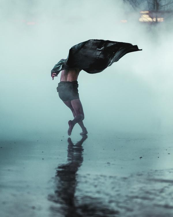 Artist man posing under rain Stock Photo