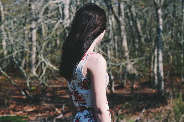 Attractive young woman posing in forest Stock Photo