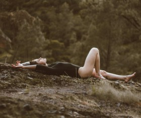 Attractive young woman relax in wild nature Stock Photo