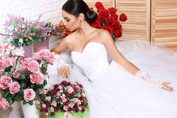 Beautiful bride in wedding dress posing among flowers Stock Photo 01
