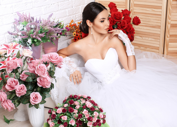 Beautiful bride in wedding dress posing among flowers Stock Photo 02