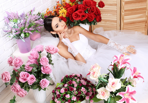 Beautiful bride in wedding dress posing among flowers Stock Photo 03