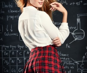 Beautiful college girl in front of blackboard Stock Photo 02