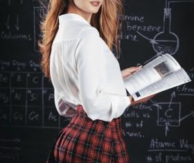 Beautiful college girl in front of blackboard Stock Photo 03