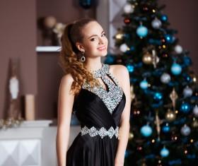 Beautiful elegant lady and christmas tree Stock Photo 02