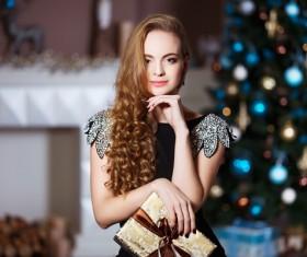 Beautiful elegant lady holding a gift box Stock Photo 01
