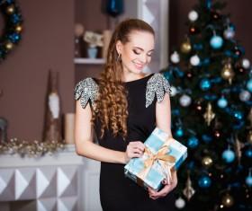 Beautiful elegant lady holding a gift box Stock Photo 02
